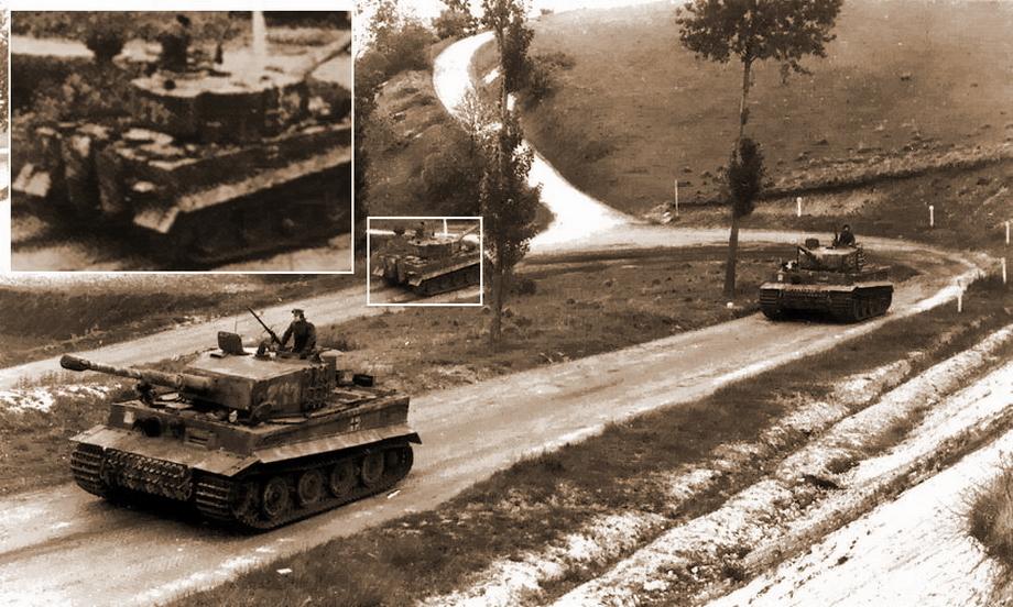 Кадр № 11. Впереди «Тигр» № 211. Тот же камуфляж на траках и расположение эмблемы, что и у танка, двигающегося за «Тигром» № 204 на предыдущем кадре. Далее «Тигр» № 212, у которого рисунок камуфляжа на лобовой плите соответствует танку 2-й роты, заснятому брошенным в Вильер-Бокаже. Следом за «Тигром» № 212 следует «Тигр» № 214. Как уже упоминалось, не все танки батальона были исправны к началу марша на фронт, и «Тигр» № 213 — один из них - «Двести двенадцатый» | Военно-исторический портал Warspot.ru